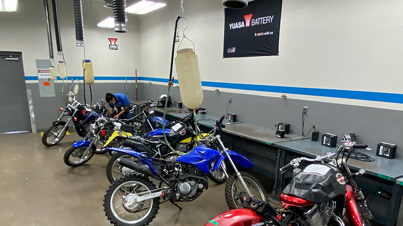 Yuasa branded lab with motorcycles at MMI