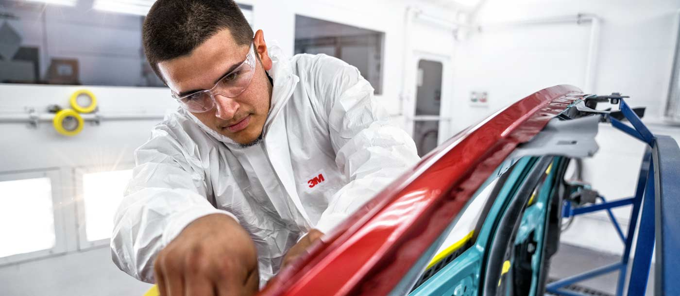 Collision repair program student at Universal Technical Institute thinking about Collision Repair Courses