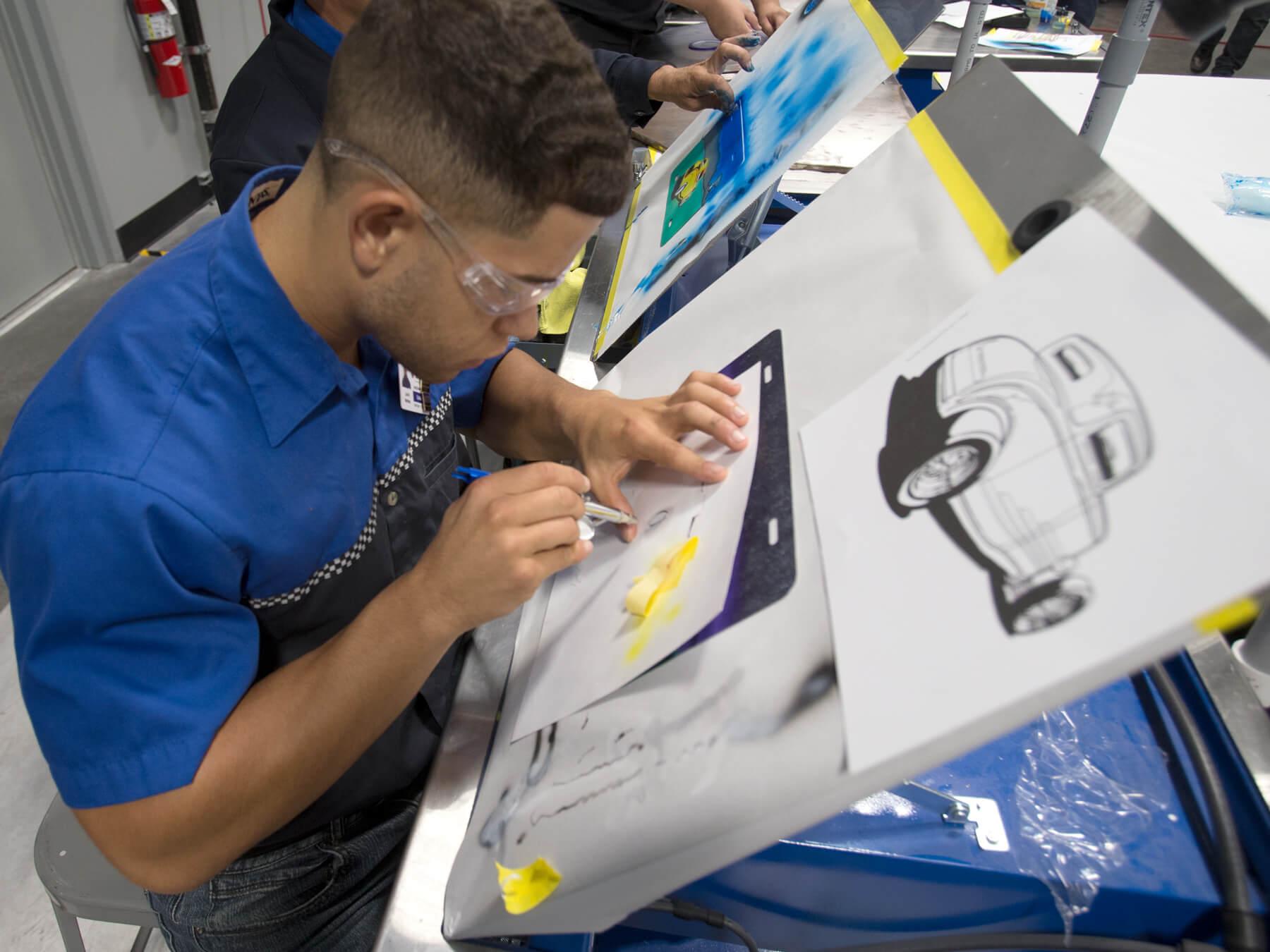 Collision Repair student practicing airbrushing