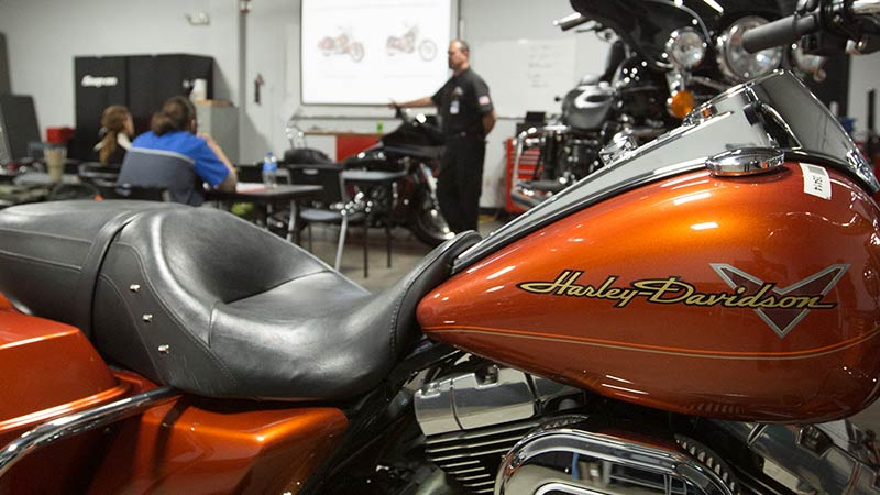 Instructor speaking at motorcycle mechanic school