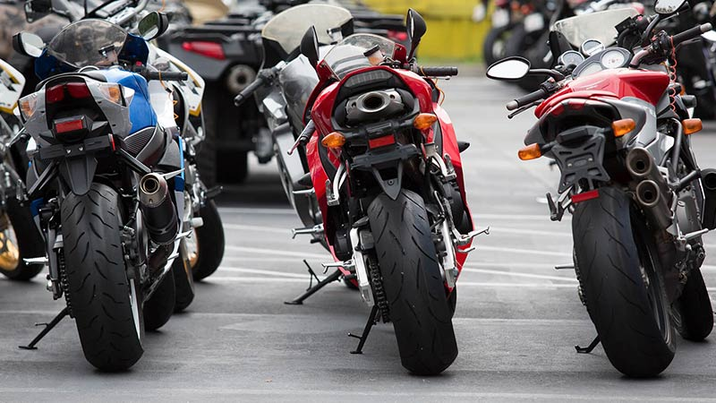 Motorcycle line up outside on campus at Motorcycle Mechanics Institute