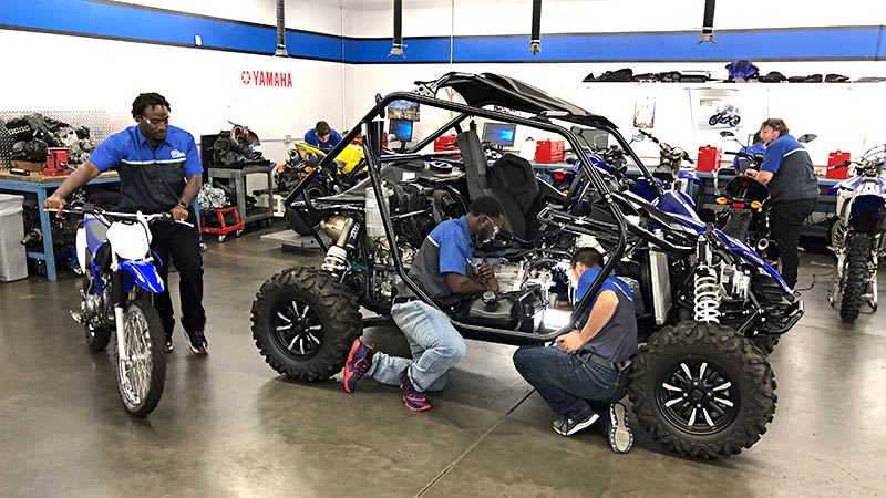 Motorcycle Mechanics Institute students training on yamaha ATV in the lab