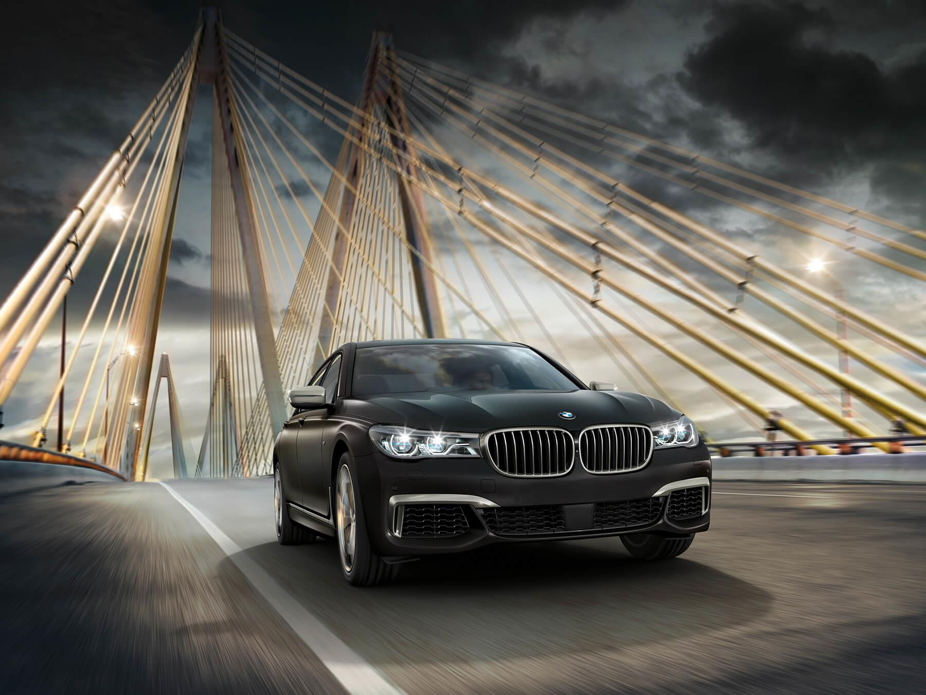 Black BMW car driving in the city freeway