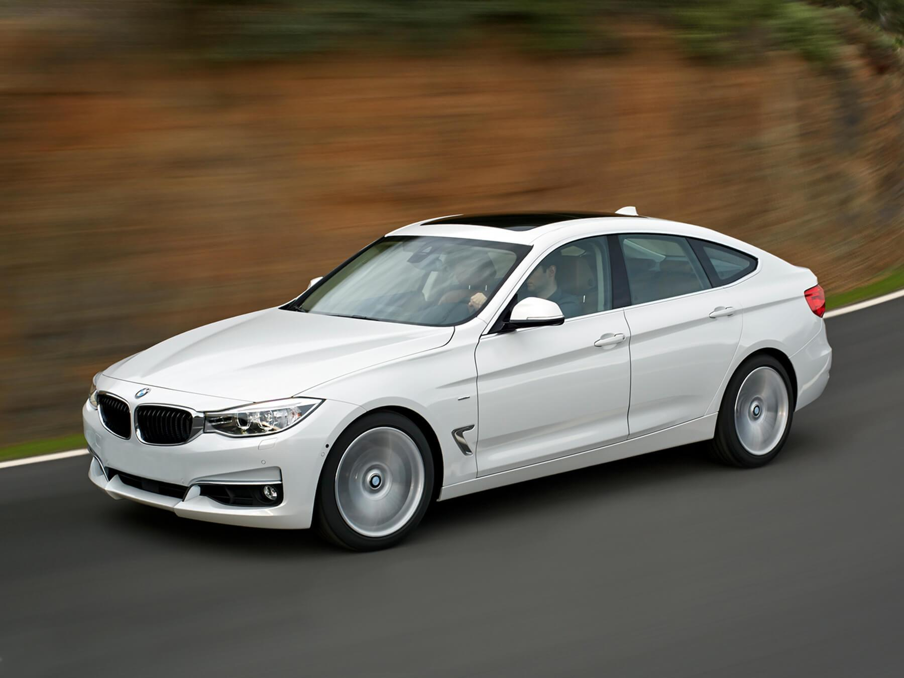 Action shot of white BMW driving along the highway