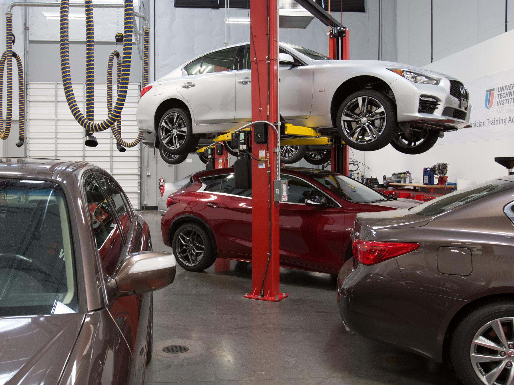 Infiniti Cars on lifts in the Infiniti auto lab