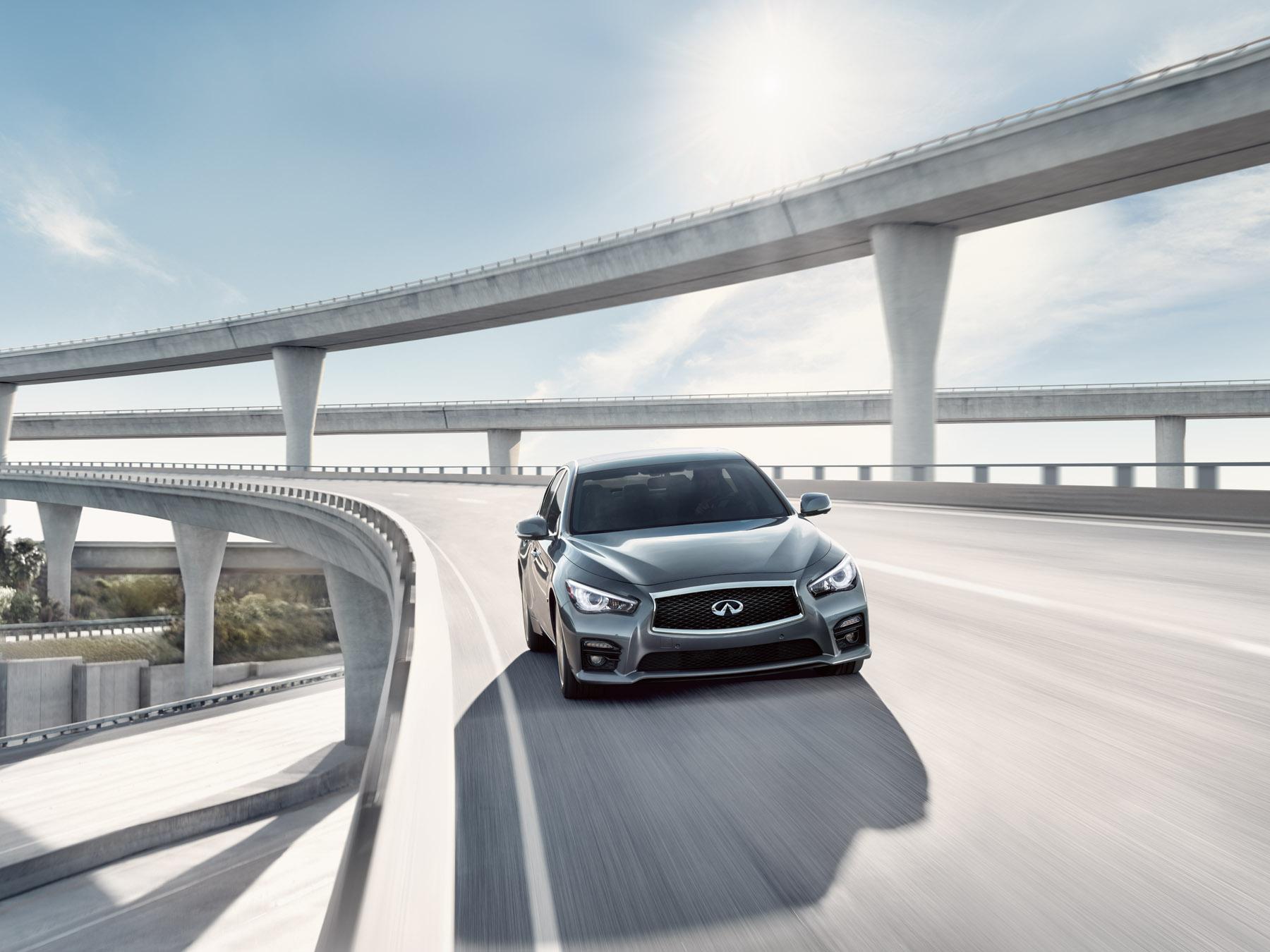Grey Infiniti Q50 driving on the highway