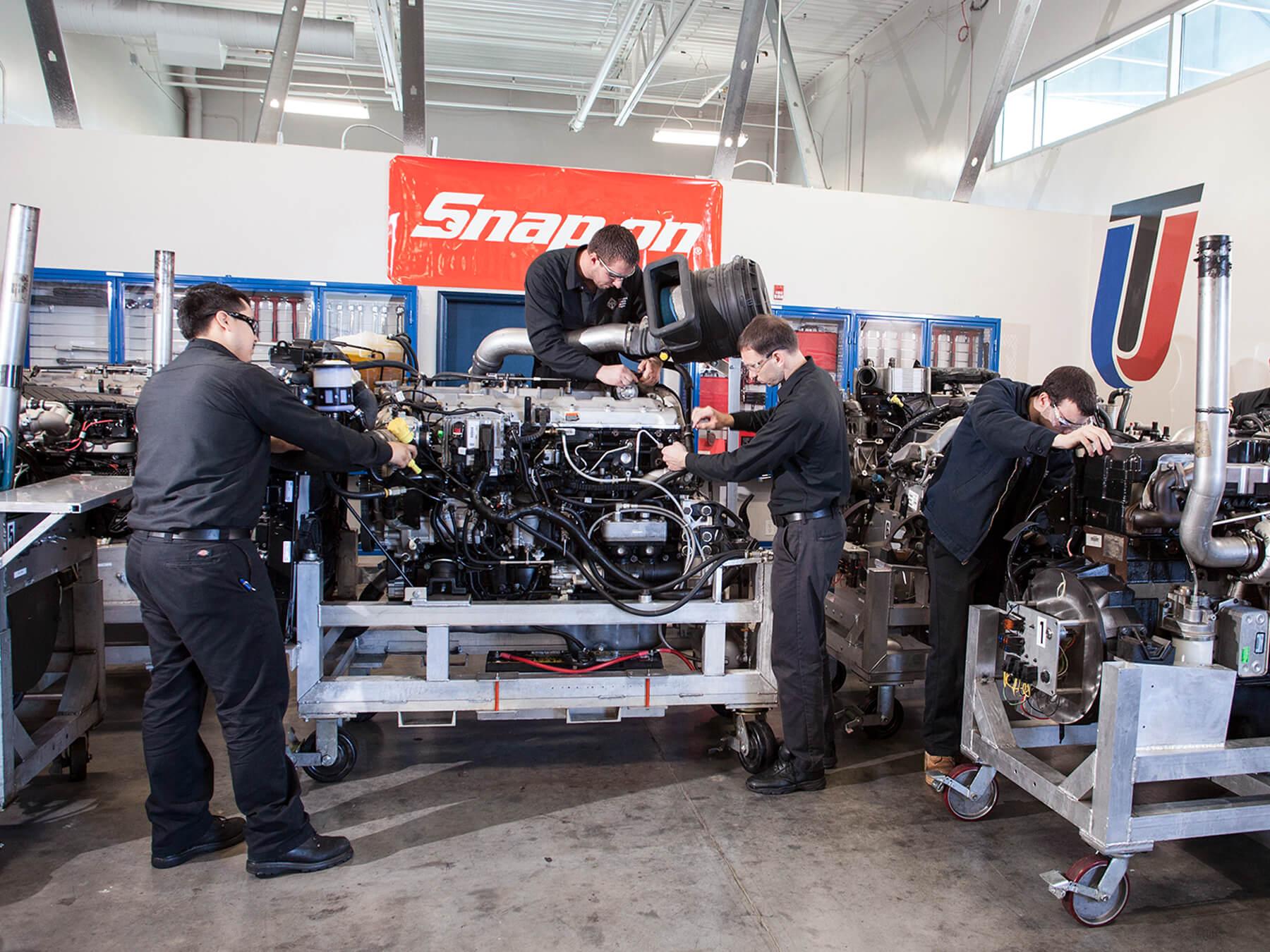 UTI students working on engines in the International Diesel lab