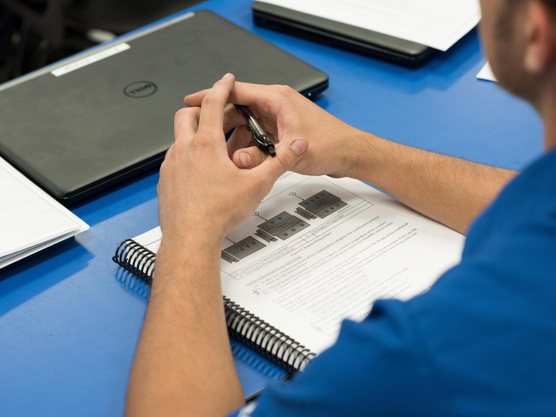 UTI Student at a Desk