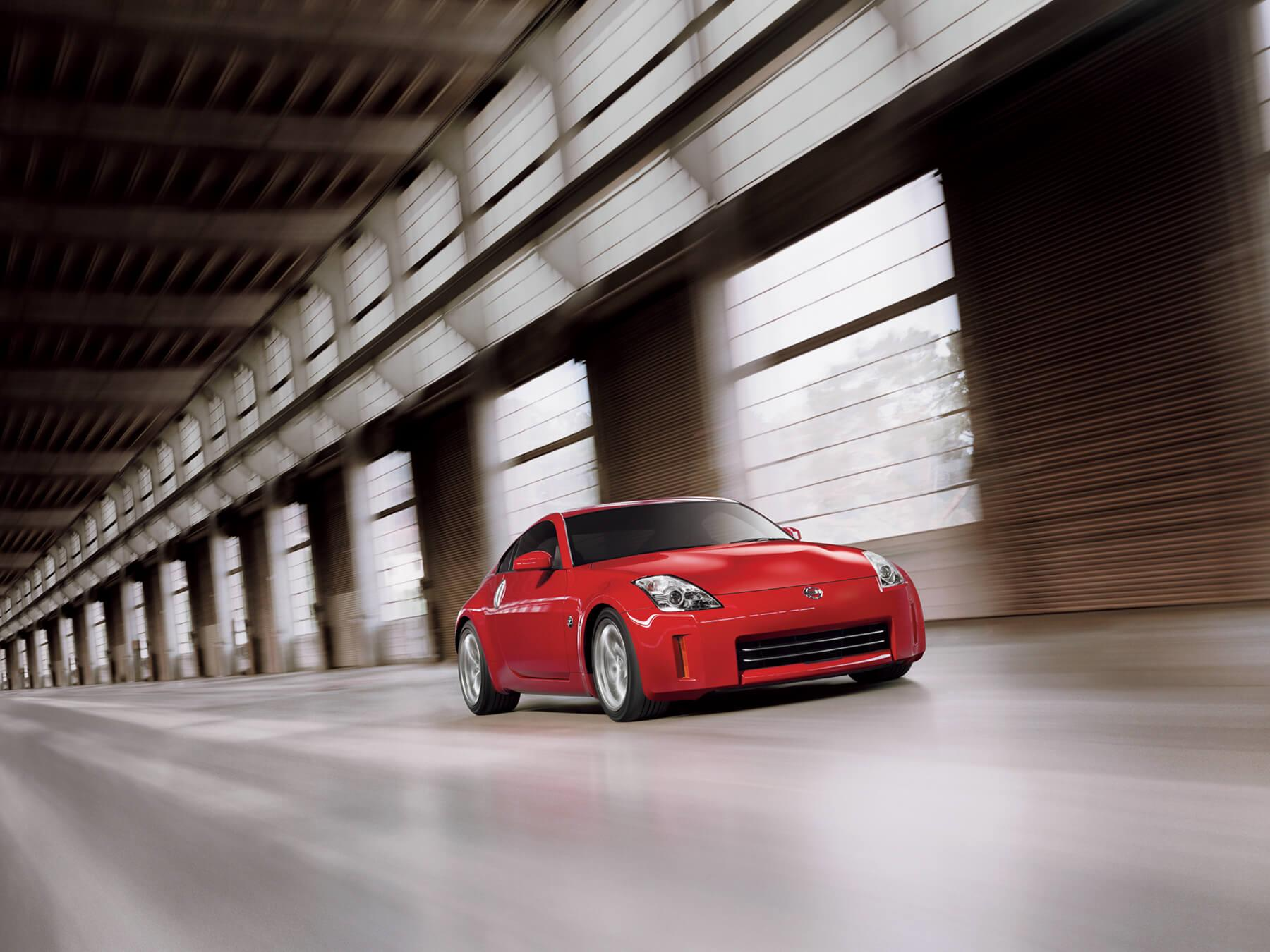 Red Nissan Z driving