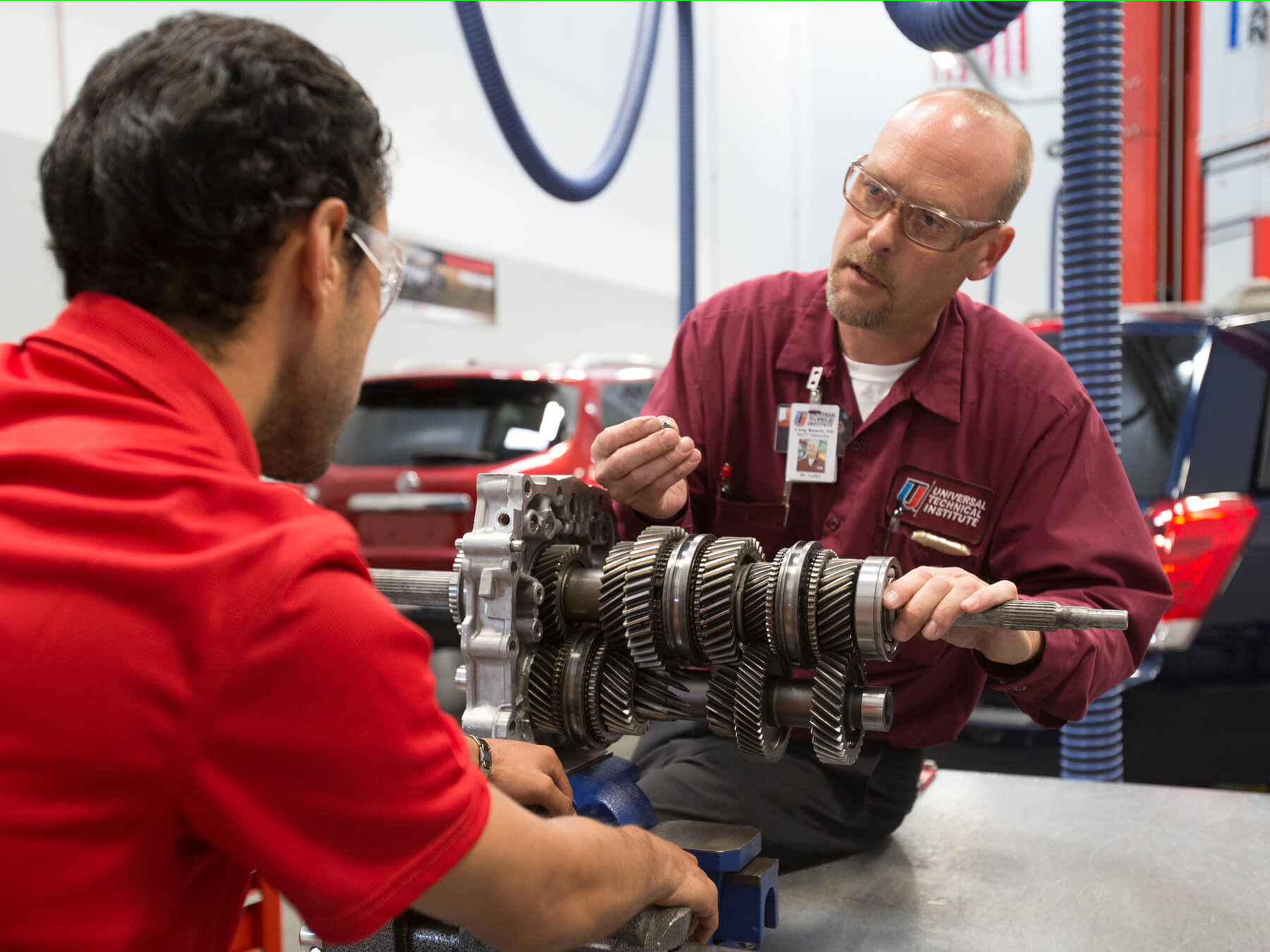 UTI student and instructor working with gears in the Nissan lab