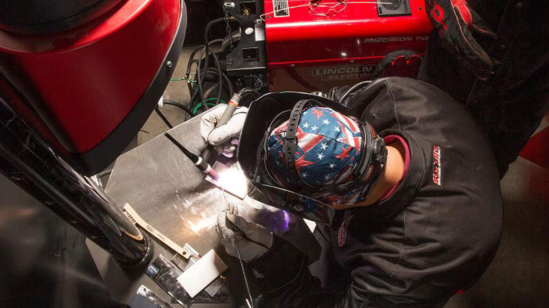 Universal Technical Institute Welding Technology Program Student Doing TIG Welding In The Lab.