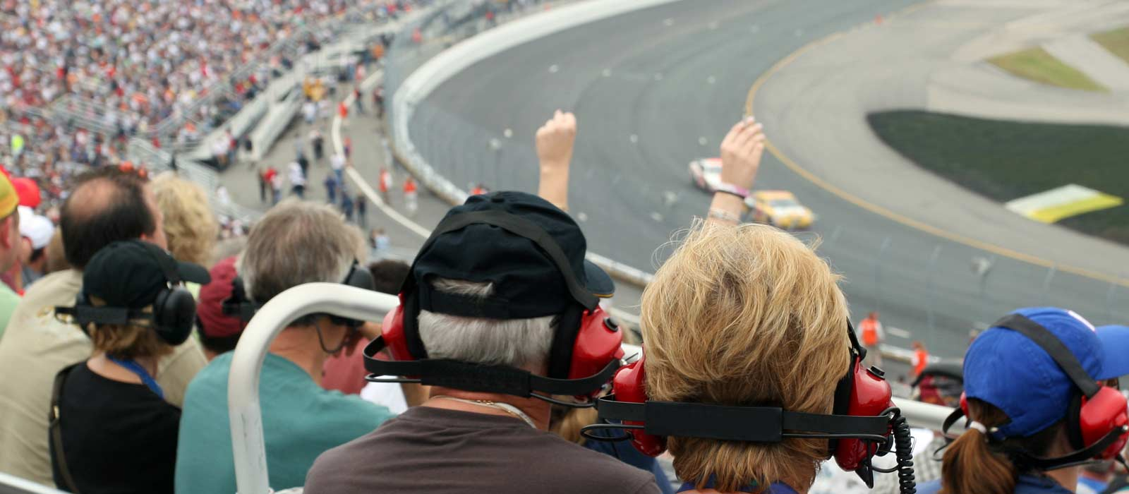 View from the stands of fans watching racing at a racetrack near campus