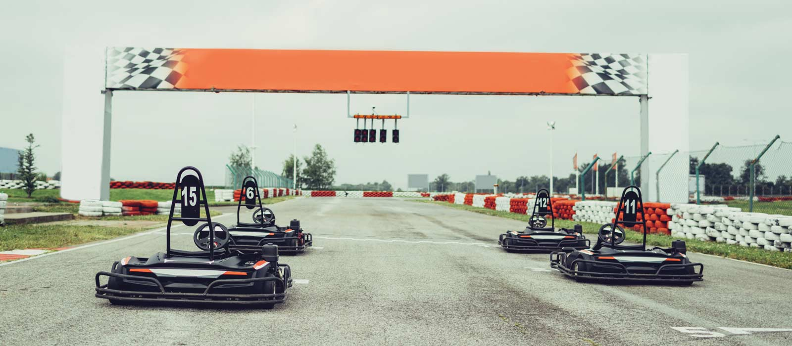 Go Karts lined up at racetrack near campus