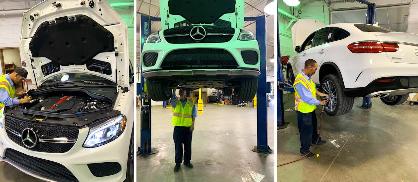 Image of employees at ADESA Auctions working on a variety of white Mercdes-Benz vehicles