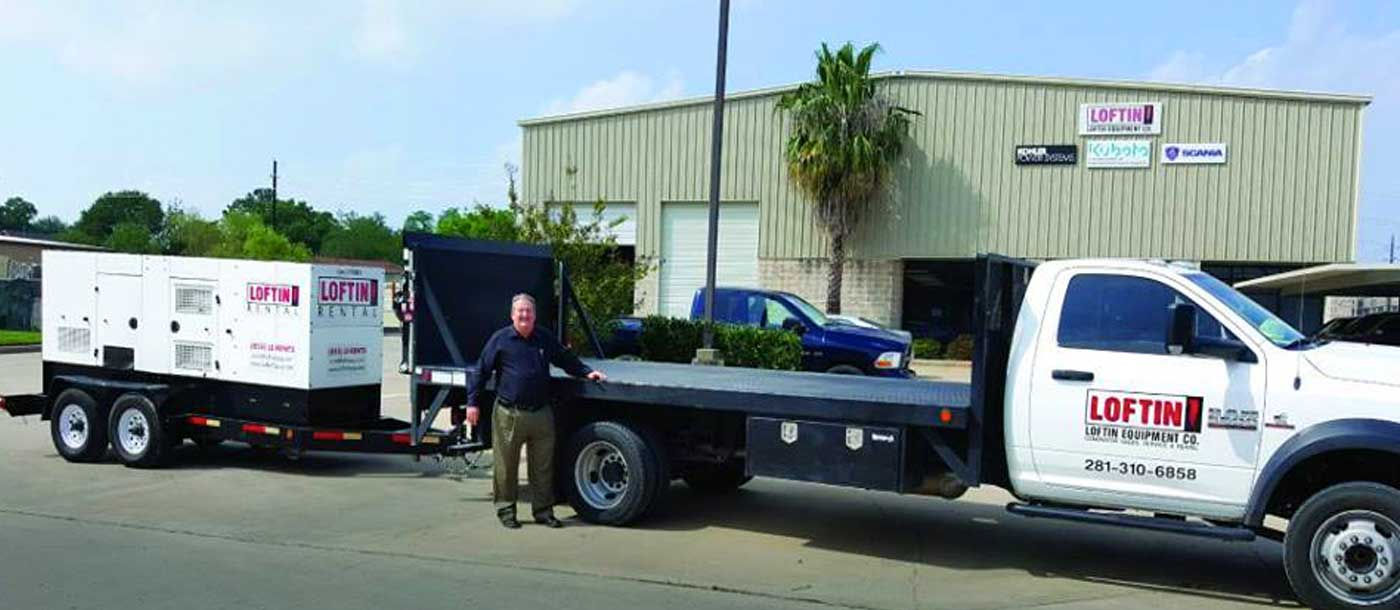 An image of an employee and a truck from Loftin Equipment Co.