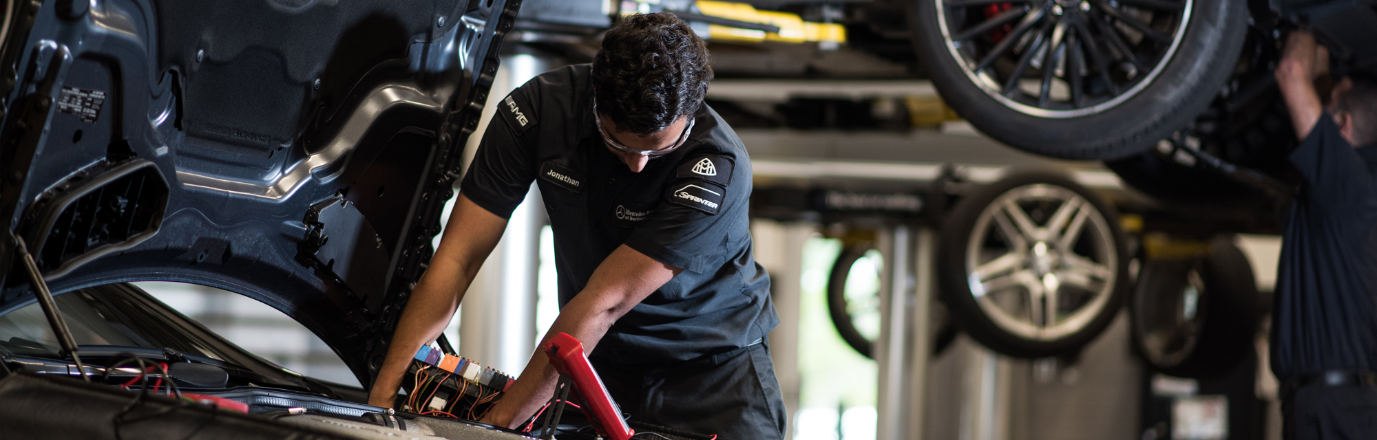 A Mercedes-Benz professional technician who graduated from Universal Technical Institute.