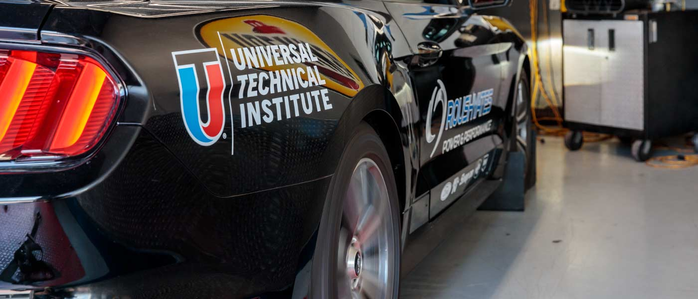 Close-up of tail light on black Mustang branded with UTI and Roush Yates Performance
