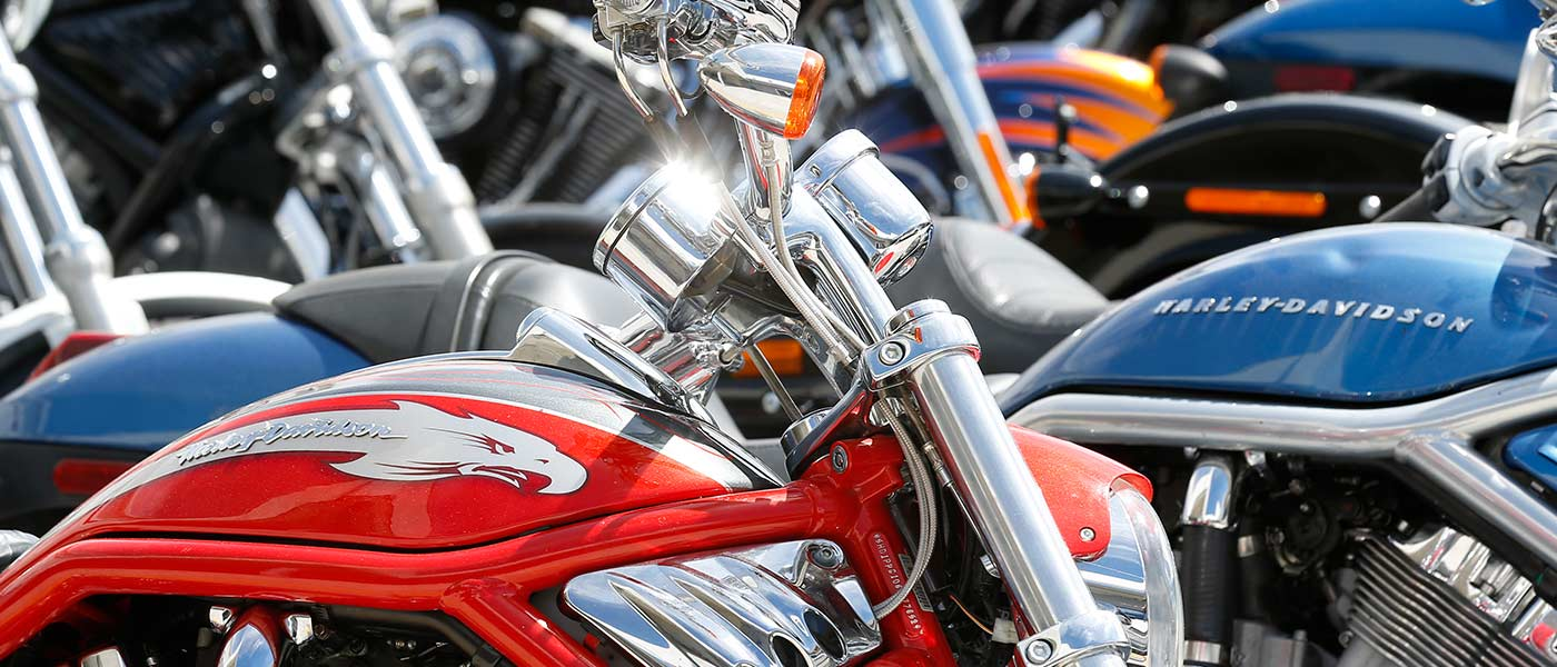 Close up of red and blue Harley-Davidson motorcycles at Motorcycle Mechanics Institute in Phoenix, AZ