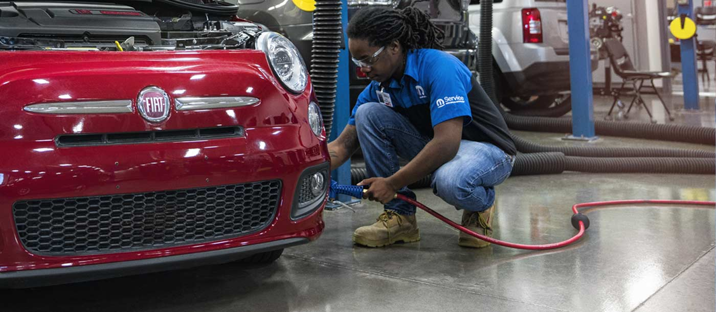 UTI Automotive student working on a car in Universal Technical Institute's lab on campus