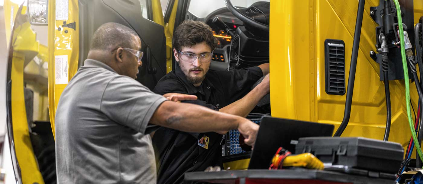 UTI Diesel instructor working with a student in Universal Technical Institute's lab on campus