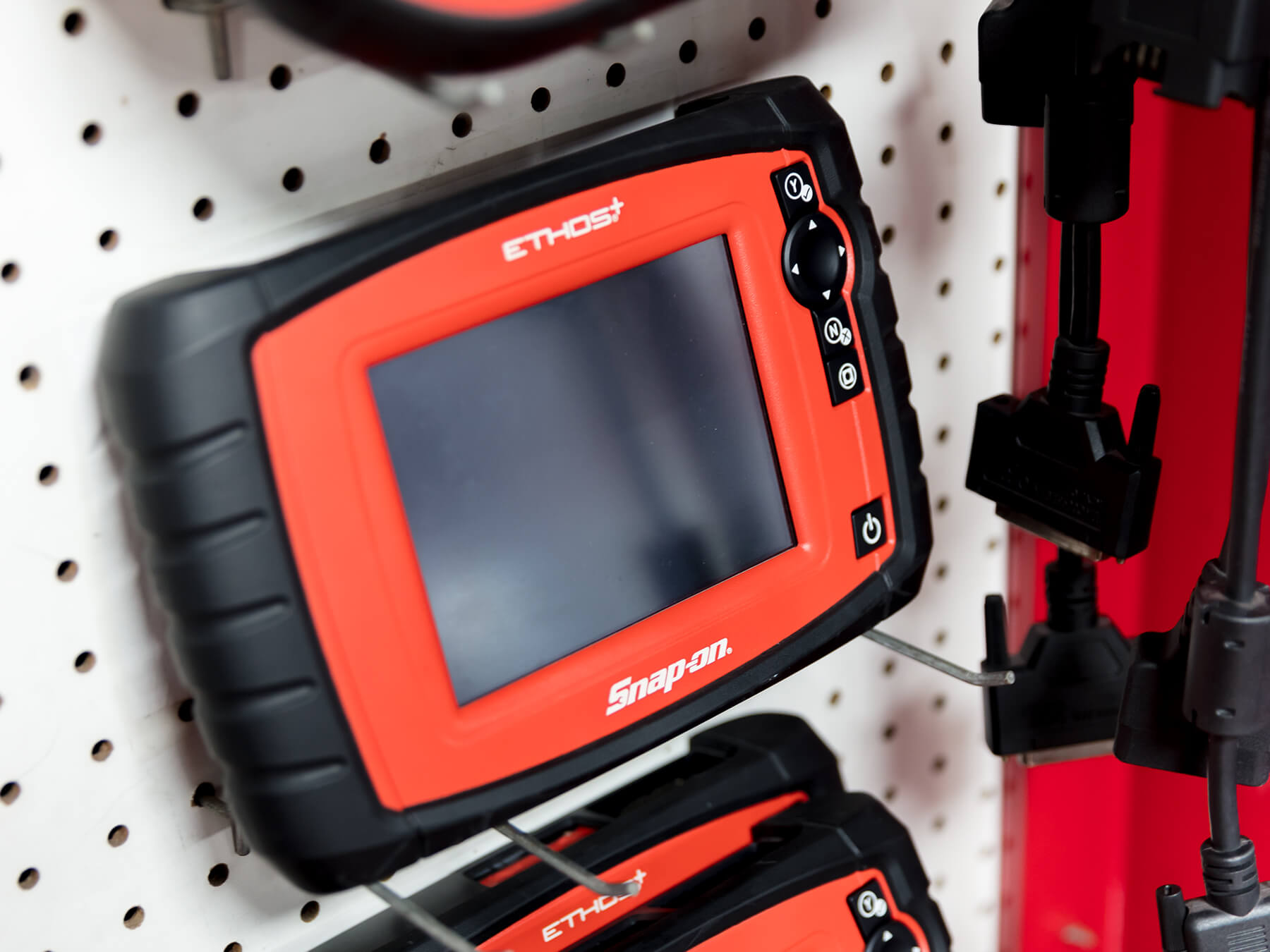Snap-on scan tool hanging on the wall