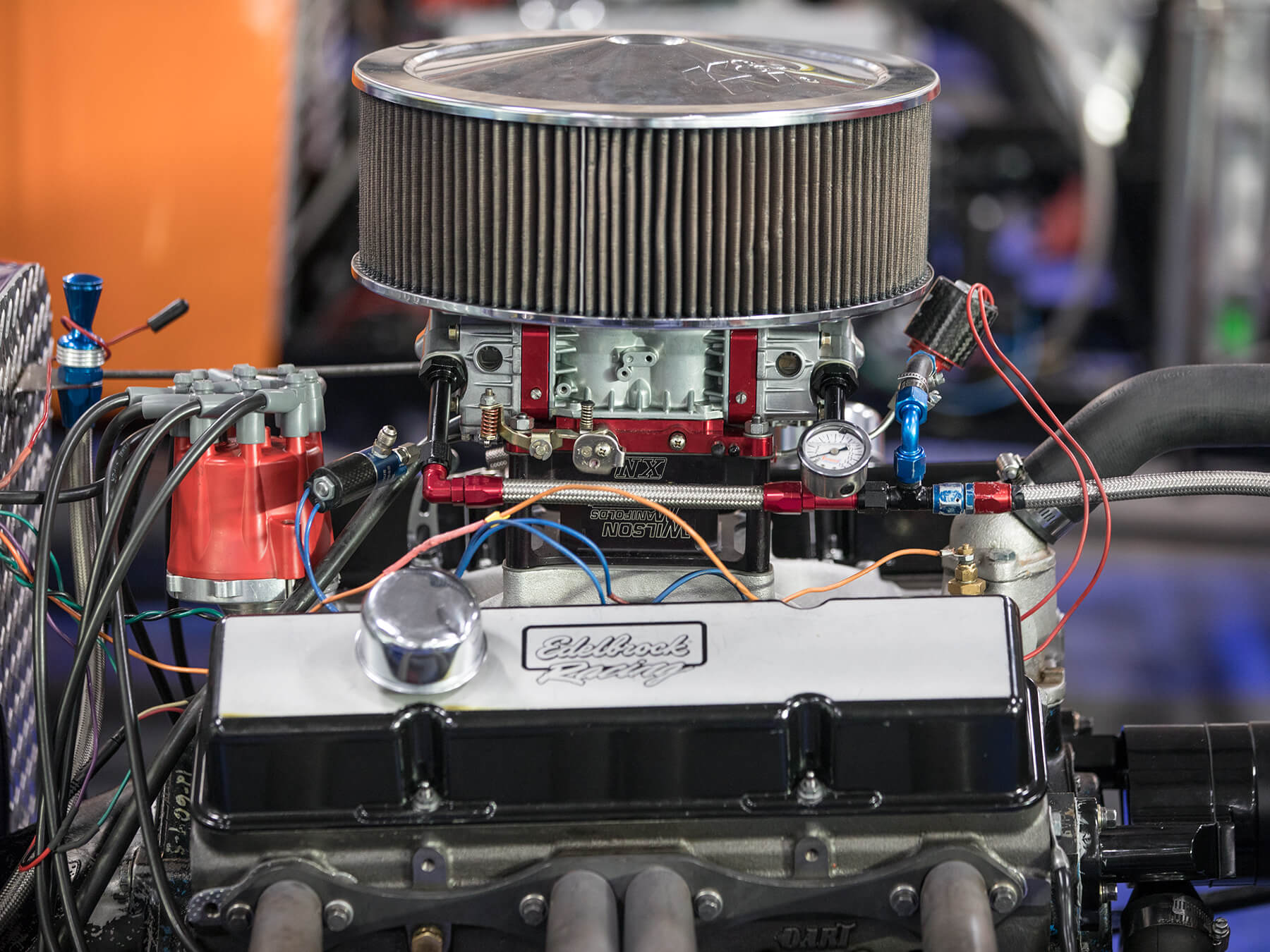 Close up photo of a Edelbrock racing engine inside of a t-bucket hotrod