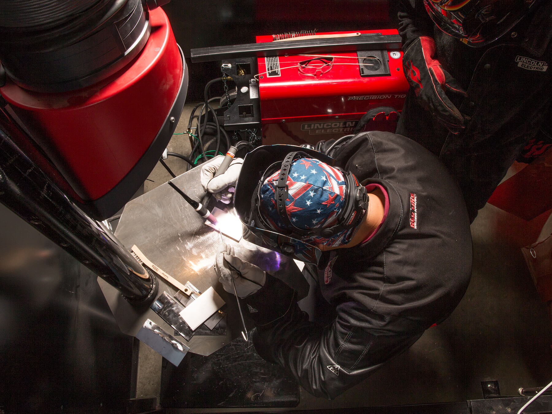 Overhead photo of UTI student welding in the welding lab