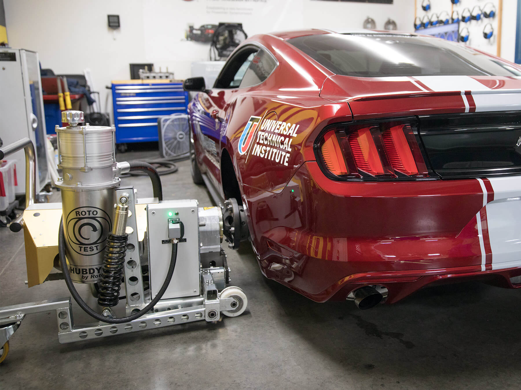 Rototest dyno machine hooked up to a red mustang